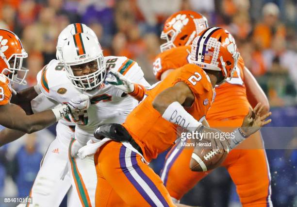 Miami Hurricanes linebacker Michael Pinckney chases Clemson Tigers quarterback Kelly Bryant in the second quarter as the University of Miami...