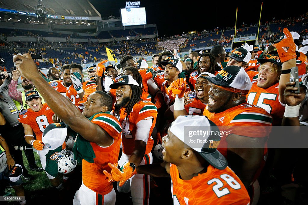 Miami Hurricanes players celebrate following the Russell Athletic Bowl against the West Virginia Mountaineers at Camping World Stadium on December 28, 2016 in Orlando, Florida. Miami defeated West Virginia 31-14.