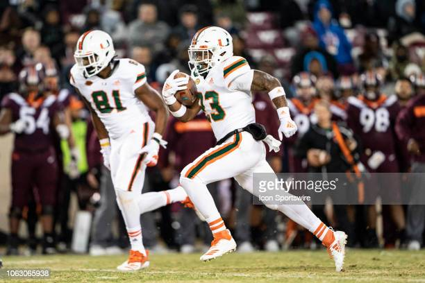 Miami Hurricanes Running Back Cam'Ron Davis runs with the ball with Miami Hurricanes Wide Receiver Darrell Langham out front to block during the...