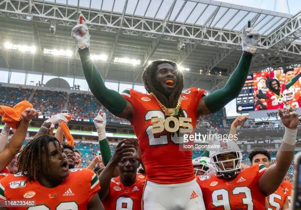 Miami Hurricanes safety Robert Knowles celebrates with the turnover chain after recoving a fumble during the college football game between the...