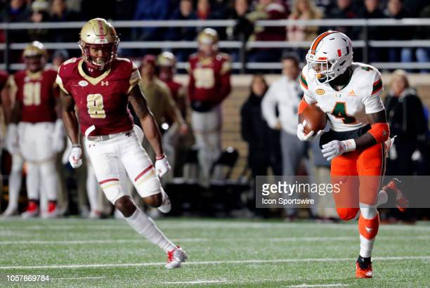Miami Hurricanes wide receiver Jeff Thomas chased by Boston College defensive back William Harris during a game between the Boston College Eagles and...