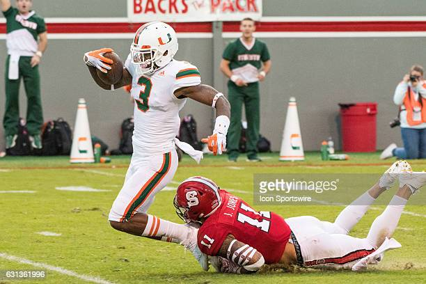 Miami Hurricanes wide receiver Stacy Coley is tackled by North Carolina State Wolfpack safety Josh Jones at the 3 yard line during a game between NC...