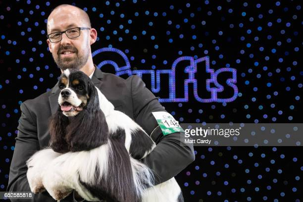Miami Ink an American Cocker Spaniel seen with handler Jason Lynn is awarded Best In Show on the final day of the Crufts Dog Show at the NEC Arena on...