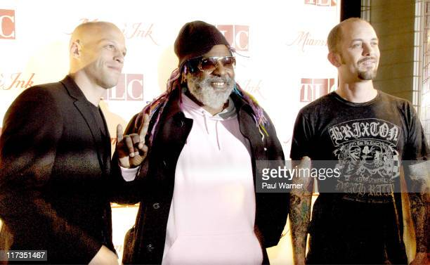 Miami Ink cast members Ami James left and Chris Garver right with George Clinton