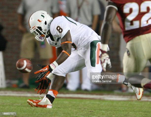 Miami kick returner Duke Johnson bobbles a kickoff in the first half against Florida State at Doak Campbell Stadium in Tallahassee Florida on...