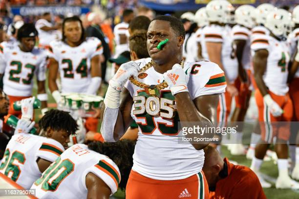 Miami linebacker Shaquille Quarterman shows off his turnover chains after recovering a fumble during the first half of the Camping World Kickoff...