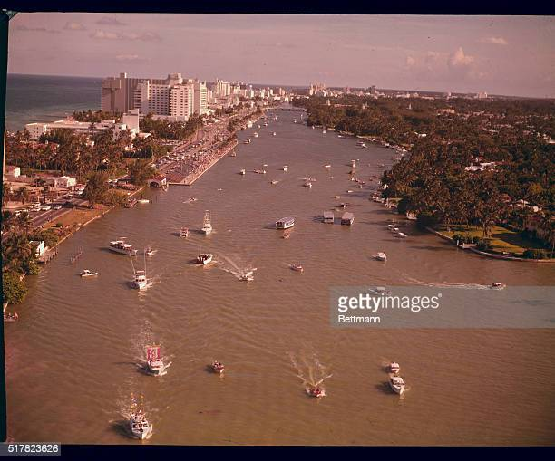 Looking North on Indian River Some of the Miami Beach Hotels are shown in the background Circles is the boat with Miss USA of 1959