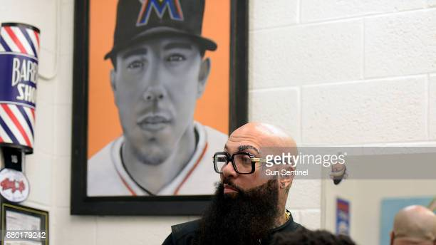 Miami Marlins barber Hugo Juice Tandron loved Marlins pitcher Alex Fernandez On the day Fernandez died he got a with a Marlins logo tattoo on the...