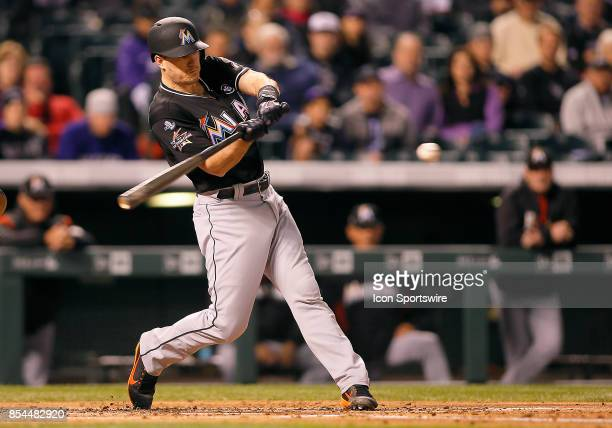 Miami Marlins catcher JT Realmuto bats during a regular season MLB game between the Colorado Rockies and the visiting Miami Marlins on September 26...