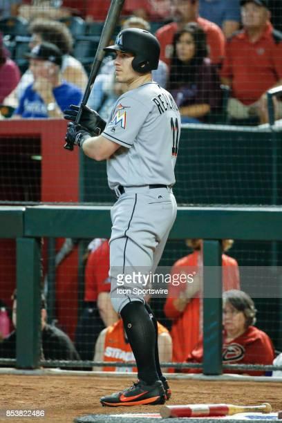 Miami Marlins catcher JT Realmuto warms up before batting during the MLB baseball game between the Miami Marlins and the Arizona Diamondbacks on...