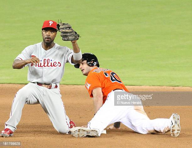 Miami Marlins center fielder Justin Ruggiano is out at second base by Philadelphia Phillies shortstop Jimmy Rollins in the fourth inning at Marlins...