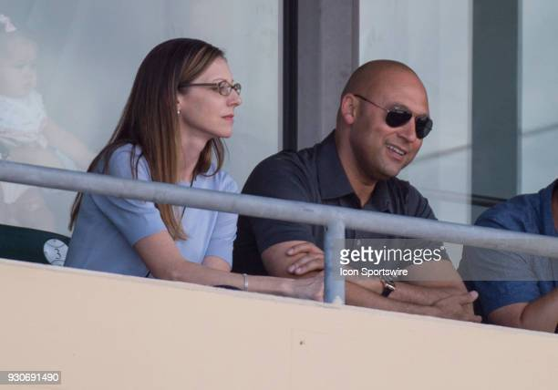 Miami Marlins CEO and partowner Derek Jeter smiles as he watches an MLB spring training game between the New York Yankees and the Miami Marlins at...