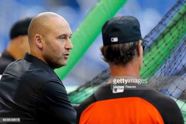 Miami Marlins CEO Derek Jeter looks on during batting practice with manager Don Mattingly prior to the game against the Pittsburgh Pirates at Marlins...