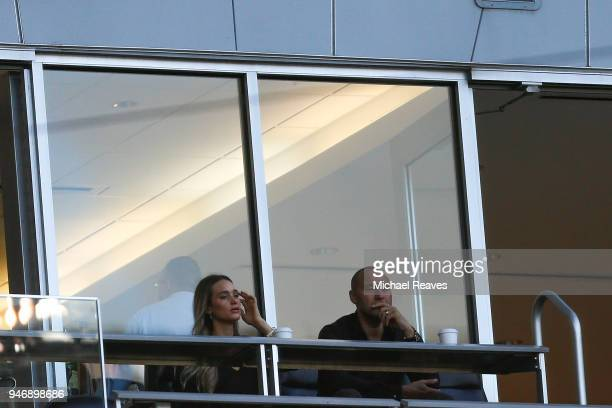 Miami Marlins CEO Derek Jeter looks on with his wife Hannah Jeter during the game between the Miami Marlins and the Pittsburgh Pirates at Marlins...