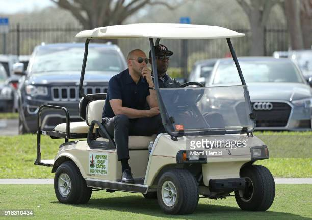 Miami Marlins CEO Derek Jeter talks with Marlins President of Baseball Operations Mike Hill during the spring training baseball workouts for pitchers...
