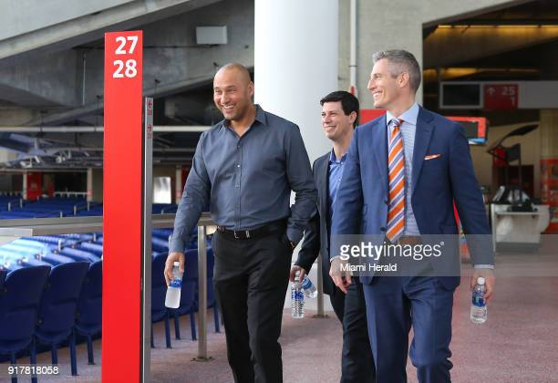 Miami Marlins CEO Derek Jeter talks with the new president of business operations Chip Bowers before a press conference on Tuesday February 13 2018...