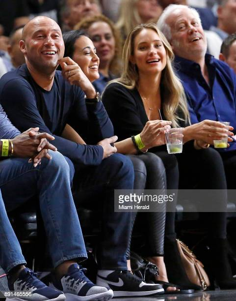 Miami Marlins chief executive and part owner Derek Jeter and wife Hannah Davis watch as the Miami Heat play the Golden State Warriors on December 3...