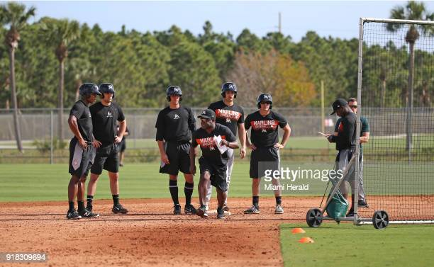 Miami Marlins coach Quinton McCracken center running drills during spring training baseball workouts for pitchers and catchers on Wednesday February...