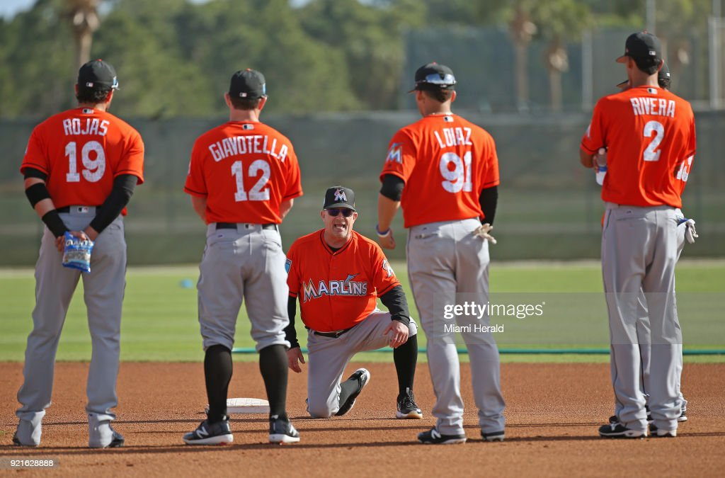 Miami Marlins first base coach Perry Hill gives instruction to his players during spring training on Tuesday, February 20, 2018 at Roger Dean Stadium in Jupiter, Fla.