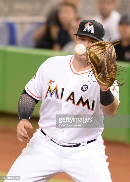Miami Marlins first baseman Justin Bour having a great year in defense is shown on this picture wile catching a ball getting Philadelphia Phillies...