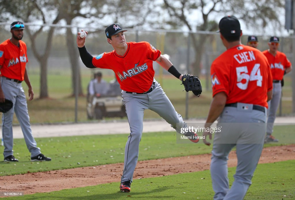Miami Marlins infielder Brian Anderson throws to first base during spring training on Tuesday, February 20, 2018 at Roger Dean Stadium in Jupiter, Fla.