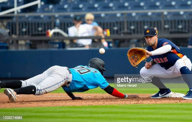 Miami Marlins infielder Jazz Chisholm avoids being tagged after attempting to steal second base during the first seventh of a spring training game...