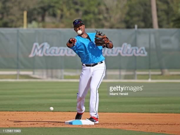 Miami Marlins infielder Starlin Castro throws to first base during the first fullsquad spring training workout on Monday February 18 2019 in Jupiter...
