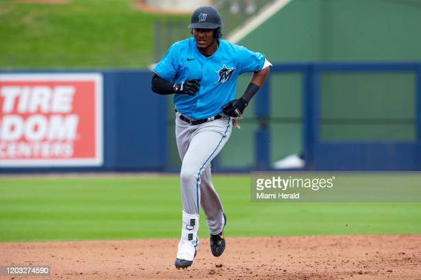 Miami Marlins' Jerar Encarnacion runs the bases after homering to center field during the ninth inning of a spring training game against the Houston...