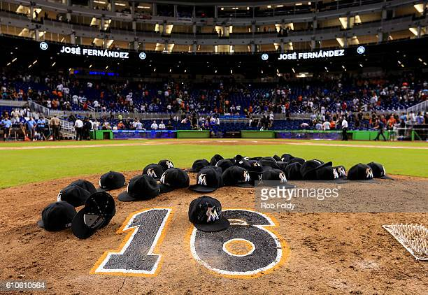 Miami Marlins leave their hats on the pitching mound to honor the late Jose Fernandez after the game against the New York Mets at Marlins Park on...