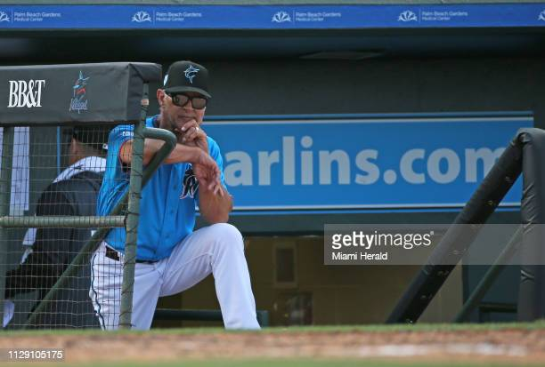 Miami Marlins manager Don Mattingly looks from the dugout during the fourth inning of a Major League Baseball spring training game against the...