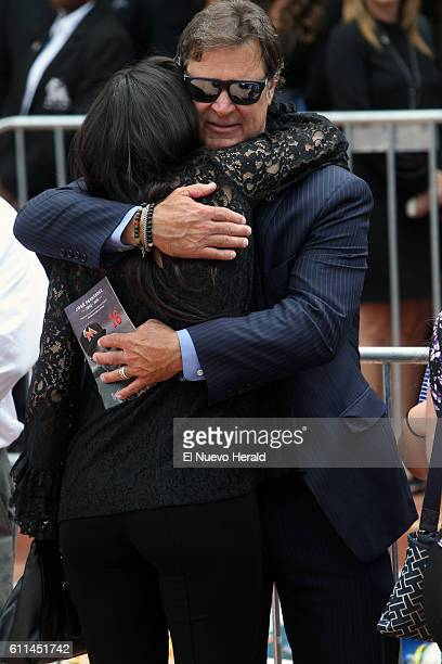 Miami Marlins manager Don Mattingly right hugs Maria Arias the girlfriend of Miami Marlins pitcher Jose Fernandez after a memorial service for...