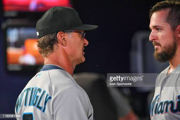 Miami Marlins manager Don Mattingly talks with starting pitcher Caleb Smith after he was pulled from the game during the MLB game between the Miami...