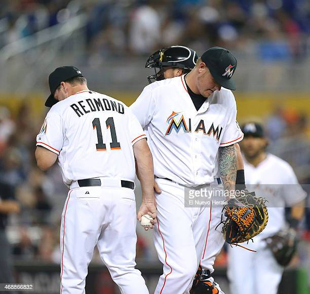 Miami Marlins manager Mike Redmond removes pitcher Mat Latos after the Atlanta Braves scored seven runs in the first inning at Marlins Park in Miami...