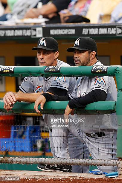 Miami Marlins manager Ozzie Guillen and pitching coach Randy St Claire look on during the game against the Pittsburgh Pirates at PNC Park on July 21...