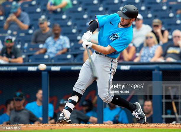 Miami Marlins outfielder Brian Miller swings at a pitch before flying out during the eighth inning of a spring training game against the Houston...