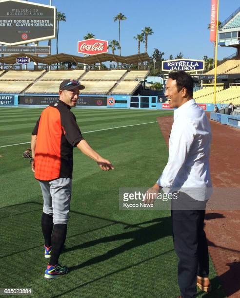 Miami Marlins outfielder Ichiro Suzuki chats with former New York Yankees teammate Hiroki Kuroda at Dodger Stadium in Los Angeles on May 18 2017...