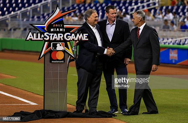 Miami Marlins owner Jeffrey Loria shakes hands with Major League Baseball commissioner Rob Manfred as former Marlin Jeff Conine looks on after...