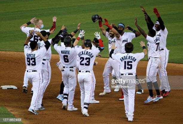 Miami Marlins perform a socially distanced celebration for the walk off RBI by Jorge Alfaro of the Miami Marlins in the ninth inning against the...