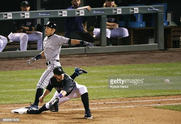 Miami Marlins pinchhitter Ichiro Suzuki beats the throw to Colorado Rockies first baseman Mark Reynolds for an infield single in the eighth inning at...
