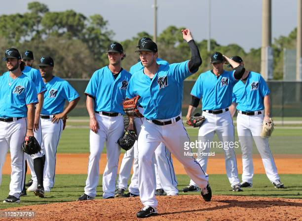 Miami Marlins pitcher Adam Conley runs drills during the first fullsquad spring training workout on Monday February 18 2018 in Jupiter Fla