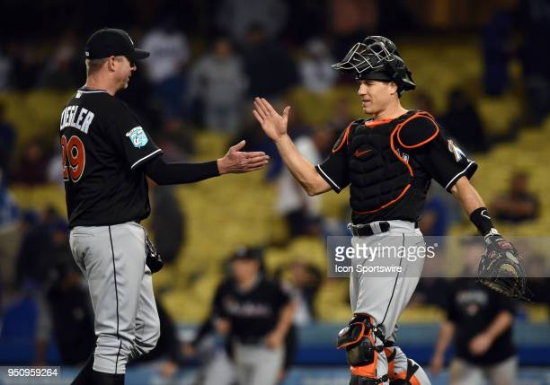 Miami Marlins Pitcher Brad Ziegler and Miami Marlins Catcher JT Realmuto celebrate the 32 victory over the Dodgers during a Major League Baseball...