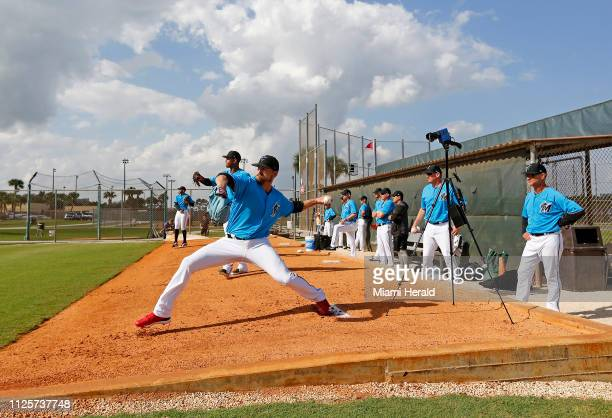 Miami Marlins pitcher Caleb Smith pitches as Marlins manager Don Mattingly looks during the first fullsquad spring training workout on Monday...