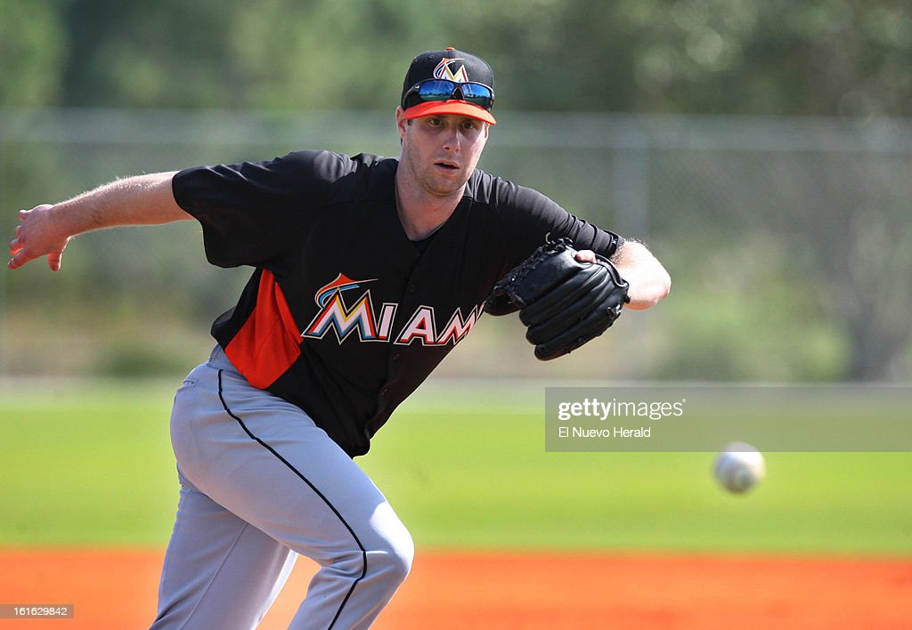 Miami Marlins pitcher John Maine executes a drill during the second day of spring training on Wednesday, February 13, 2013, at Roger Dean Stadium in Jupiter, Florida.