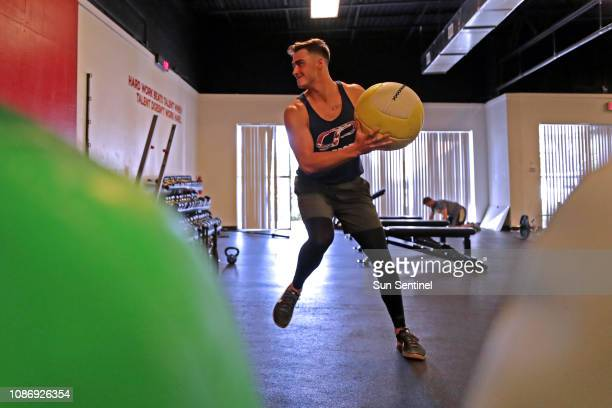 Miami Marlins pitcher Jordan Holloway works out with a medicine ball as part of his rehab program to recover from Tommy John surgery at Cressey...