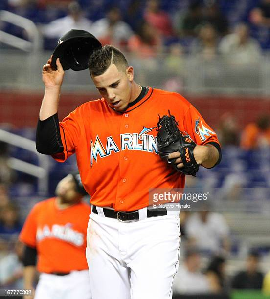 Miami Marlins pitcher Jose Fernandez reacts to giving up a single to New York Mets third baseman Justin Turner during firstinning action at Marlins...