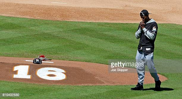 Miami Marlins player Dee Gordon is shown in front of a memorial on the pitcher's mound at Marlins Park for Marlins pitcher Jose Fernanedez who died...