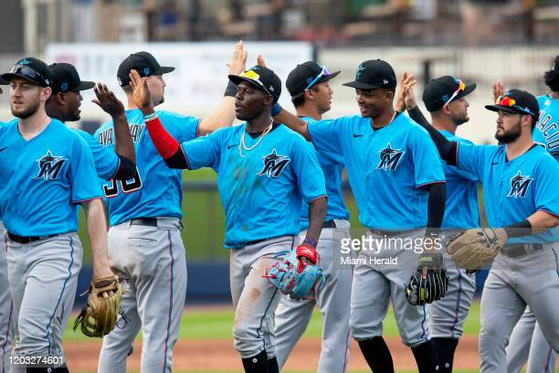 Miami Marlins players celebrate a victory in a spring training game against the Houston Astros at FITTEAM Ballpark of the Palm Beaches Tuesday Feb 25...