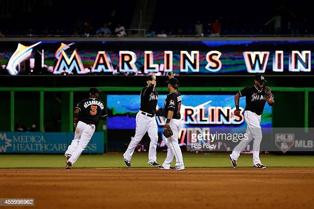 Miami Marlins players celebrate after defeating the Philadelphia Phillies in the game at Marlins Park on September 23 2014 in Miami Florida