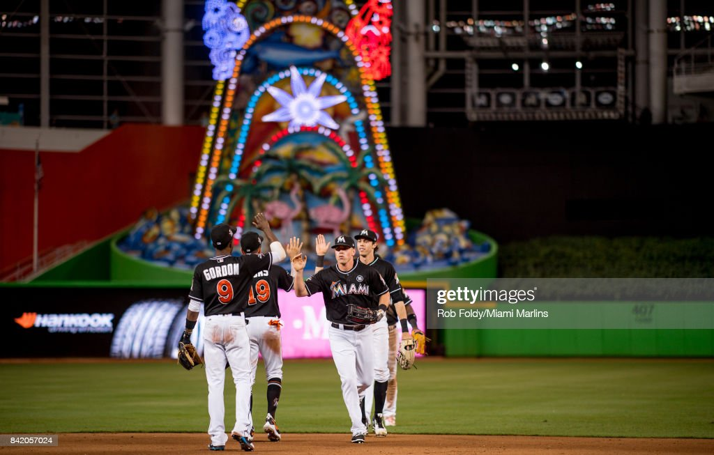 Miami Marlins players high-five after the game against the Philadelphia Phillies at Marlins Park on September 2, 2017 in Miami, Florida.