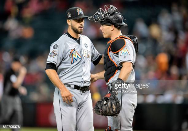 Miami Marlins relief pitcher Kyle Barraclough and catcher JT Realmuto celebrate after the final out of the MLB baseball game between the Miami...